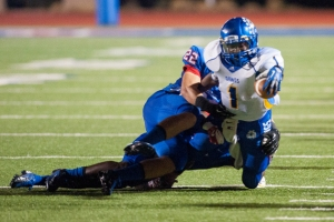 Cove's Philip Baptiste stretches for more yardage. (David Morris/Copperas Cove Leader Press)