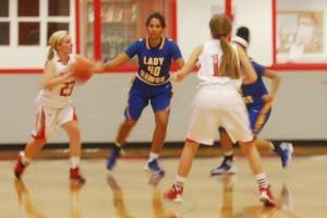 Lorena's Ashlyn Bell is defended by Cove's Tateyana Harris at Lorena Gym on December 3, 2013. (John Henry Medina / HOTSN)