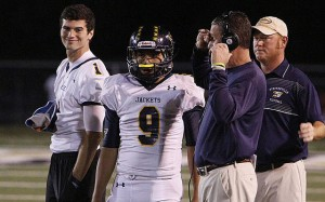 Jarrett Stidham managed a smile even after inuring his throwing hand on Stephenville's opening drive of the game at Big Spring Friday. Anthony Chavarria, 9, took over at quarterback, passing for 380 yards, six touchdowns and two interceptions in the Yellow Jackets' 64-57 loss. (Photo by RUSSELL HUFFMAN)